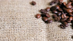 Coffee beans on the sackcloth. Dolly shot. Stock Footage