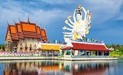 Thailand landmark in koh Samui. Shiva sculpture and Buddhist temple Stock Photos