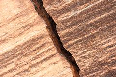Broken brick wall with crack - stock photo