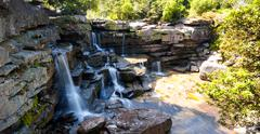 Waterfall in wilderness of Cambodian jungle forest Stock Photos