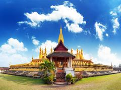 Laos travel landmark golden pagoda wat Phra That Luang in Vientiane Stock Photos