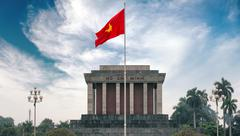 Ho Chi Minh mausoleum in Hanoi with red communistic flag Stock Photos