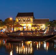 Hoi An ancient town at night reflects in channel water Stock Photos