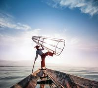 Intha fisherman on boat in Inle Lake in Shan state, Myanmar (Burma) - stock photo