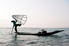 Myanmar travel destination background. Inle Lake fisherman Stock Photos