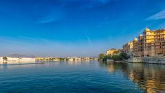 Waterfront city view of Udaipur in India from tourist boat Stock Photos