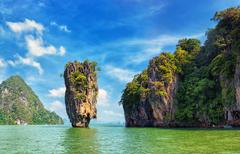 Mountains and cliffs in sea water of Thailand. James Bond island landmark - stock photo