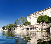Pichola lake in India Udaipur Rajasthan. City buildings architecture - stock photo