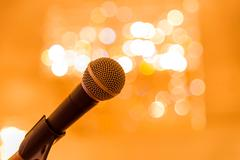 Microphone in meeting room before a conference - stock photo