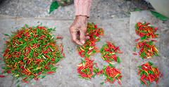Chili pepper on local market on streets of Luang Prabang - stock photo