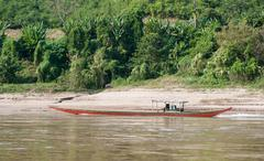 Countryside of Laos. Boat from Huay Xai by mekong river - stock photo