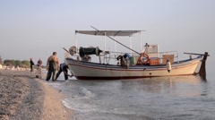Fisherman's boat which is moored there to be cleaned of salt deposited on hull - stock footage