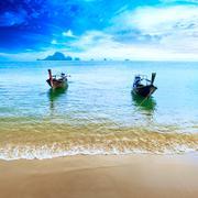 Travel boats on Thailand beach. Tropical coast landscape background Stock Photos