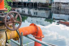 valve of water pipe for pump system in canal - stock photo
