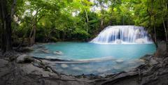 Waterfall and pond with blue water in Thailand panorama photography Stock Photos