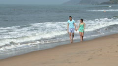 Couple walking by the sea Stock Footage