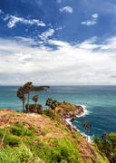 Promthep Cape Phuket viewpoint in Thailand with white clouds on blue sky in L Stock Photos
