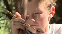 Boy with bow and arrow Stock Footage