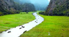 Vietnam travel landscape. Twisted river and mountains of Tam Coc Ninh Binh Stock Photos