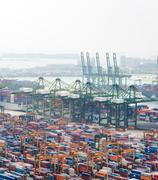 Bird eye panoramic view of busiest Asian cargo port Stock Photos