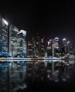 Singapore skyline night panorama. Modern urban city view of business district - stock photo