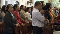 Church mass in Vietnam, singing religious songs in Hanoi, Asian ethnicity Stock Footage
