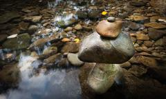 Stones tower on mountain creek natural background Stock Photos