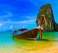 Stock Photo of Thai wooden boat on exotic tropical location near Phuket island