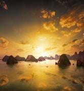 Sunset over the islands of Halong Bay in northern Vietnam. Amazing landscape  Stock Photos