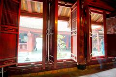 Decorated windows of Temple of Literature in Hanoi, Vietnam - stock photo