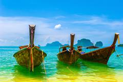 Thailand fishing boats in tropical paradise location in Asia - stock photo