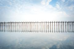 Tranquil and calm photography of peace and silence landscape of wooden bridge Stock Photos