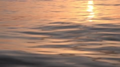Sea waves colored by the sun before sunset Stock Footage