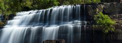 Smooth water of waterfall Stock Photos
