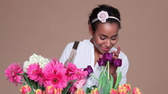 Young woman choosing flowers Stock Footage