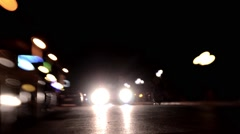 Auto and pedestrian traffic seen through a lens Lensbaby Stock Footage