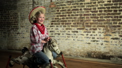 Young girl rocking on rocking horse Stock Footage
