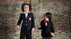 Two young boys jumping up and down Stock Footage