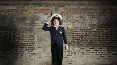 Young boy dressed as sailor jumping up and down Stock Footage