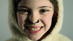 Happy looking young girl dressed as sheep - stock footage