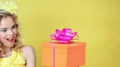 Young woman with gift Stock Footage