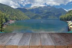 Empty wooden flooring against the lake in mountains - stock photo