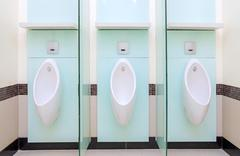 Urinals Men public in toilet room Stock Photos