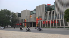 Traffic drives past the National Assembly Hall in Hanoi, Vietnam Stock Footage