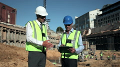 Mature men meeting on construction site Stock Footage