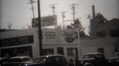Stock Video Footage of 1946: 7up parking signs 25 cents check luggage guns in rear. SAN DIEGO,