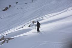 freeride skier skiing in deep powder snow - stock photo