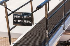 Bridge of a private luxury ship with a no entry private yacht sign Stock Photos