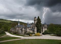 Thunderstorm with lightning in Lowenburg castle - stock photo