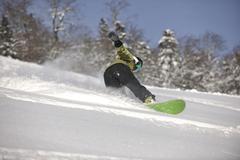 snowboarder woman enjoy freeride on fresh powder snow - stock photo